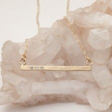 Cross Bar Necklace {14K Gold} Off center to the right: XXVII with two white gems after it on the right