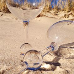The Beach Glass-- plastic wine glasses that stick upright in the sand and also float. Various colors.