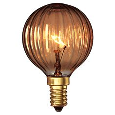When decorating a room, the small details are key. This gorgeous Calex Decorative Golf Ball Bulb in Goldline Rustic is one of a range of carbon filament decorative light bulbs, with a retro feel, that will add real character to your home lighting. This smoked glass bulb has a life of 1000 hours and is ribbed, which gives an unusual effect on the wall when lit. £4 from John Lewis