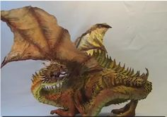 Amazing paper sculpture by local artist [VIDEO] http://worldofarts.eu/amazing-paper-sculpture-by-local-artist/    #SCULPTING #DRAGON #PAPERART #WORLDOFARTS