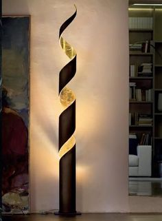 This is a floor lamp and is black and gold. It is a modern lamp . - This is a floor lamp and is black and gold. It is a modern lamp and its light is very delicate. Modern Lighting, Lighting Design, Lighting Ideas, Blitz Design, Pvc Pipe Crafts, Wood Crafts, Bamboo Lamp, Luminaire Design, Pipe Lamp