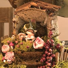 """One Of A Kind hand carved """"Mushroom Fairy House"""" - exquisite and totally unique gift idea.  Beautifully made with great attention to detail making all feel enveloped by magic.  Decorated with preserved moss, mixture of dried flowers, fruits, seeds with little handmade clay fairy and tiny battery operated lights, all of them are just magical.  All of our Fairy Houses are handmade from building the base to decorating the interiors.  Playing with colours and precision give to all of them a…"""