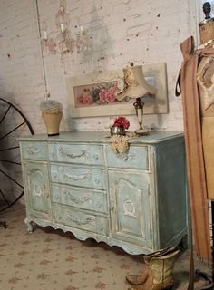 I see these old French Provential dressers.....this is so pretty painted this way.