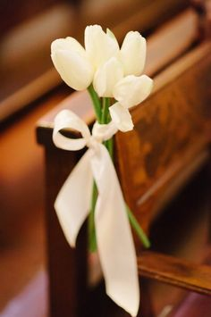 White Tulip Church Wedding Ceremony Decoration Idea / http://www.himisspuff.com/white-tulip-wedding-ideas-for-spring-weddings/6/