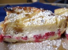 Raspberry and Cream Cheese Stuffed French Toast  Serves:6  Prep Time:15 Min  Cook Time:20 Min  Ingredients:  1 (8oz) pkgcream cheese softened  12(3/4 inch thick) slices day old brioche challah or hawaiian bread  1 cfresh raspberries *  3eggs (beaten)  3/4 chalf-and-half, light cream, or milk  3 Tbspsugar  1/2 tspvanilla  1 dash(es)of salt  pure maple syrup.