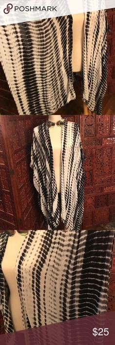 Sarong/wrap Black, white and gray sarong/wrap.  Excellent for beach or that island trip this winter.  Looks gorgeous as either.  Very soft cotton material.  Never worn. Excellent condition.  Sunglasses are also for sale in my closet. Tops