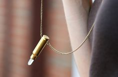 Bullet Crystal Necklace--Just went to the Black Mountain Farmer's Market this past weekend and saw Bullet shell crystal earrings, on this idea only with a dangle...thinking about this for the shell from my Dad's Funeral Gun Salute...