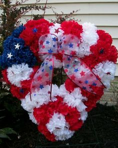 """Patroitic Heart Wreath 16"""" by Silkmama.com. $49.99. * Updated photo as of 4/2/12. * Product could vary from picture due to it being hand made and availabilty of similar product. Red, White and Blue Carnations. 12"""" Foam Heart Base; appx. 16"""" finished. Great for Home Decor, Memorial Day thru Labor Day, Grave site Memorial. Appx 16"""". Red, White and Blue Carnations on an open heart foam wreath. Great for Home Decor, Memorial Day thru Labor Day, Grave site Memorial. Designed and han..."""
