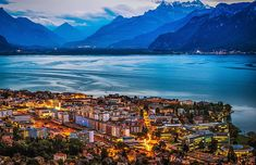 An amazing viewpoint as the sun sets on the city of Vevey, on Lake Geneva, Switzerland. Vevey, Lake Geneva Switzerland, Places In Switzerland, Lonely Planet, Places To Travel, Places To See, Honeymoon Places, Beautiful Places In The World, Amazing Places