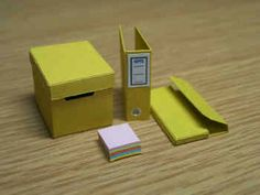 Three-ring binders and a file-folder - a must for my dollhouse study | Source: Delphi Miniatures