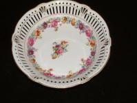 Antique porcelain bowl with cutwork sides.