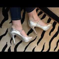 Steve Madden brytini heel size 8.5 Used condition. Silver glitter kind of like crushed tin foil in color. Peep toe. There are stains and marks. Steve Madden Shoes