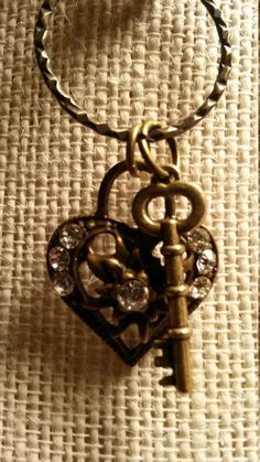 .Valentines Day Key to my Heart Necklace. Rhinestones on the Antique Brass Heart with an Antique Brass Skeleton Key.  This is a custom piece, One of a Kind!  Pendant is approximately 1/2 inches long x an inch wide it includes an 18 inch black wax leather necklace.  As always more pictures available if wanted, just email me..  Thank you for visiting our shop! Debra