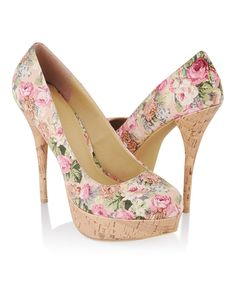 These sweet floral pumps feature a faux corked platform and stiletto heel. Round toe. Padded insole. Textured outsole.