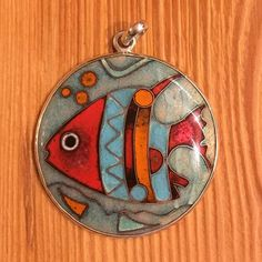 A personal favorite from my Etsy shop https://www.etsy.com/listing/592425064/cloisonne-enamel-pendant
