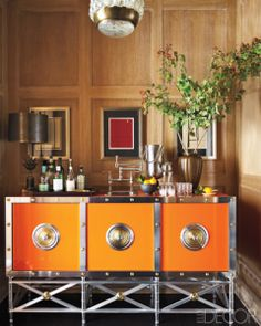 A Manhattan apartment's bar area contains a stainless-steel sideboard and a circa-1955 Arredoluce light.     Photographer: Eric Piasecki   Designer: Steven Gambrel   Featured in: Room to Grow   Issue: July 2011
