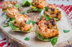 Chipotle Lime Grilled Shrimp and Corn Guacamole Mini Tostadas by closetcooking: Tasty little morsels! #Appetizer #Tostados #Shrimp #Corn