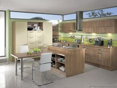 #Kitchen Idea of the Day: Modern Two-Tone Kitchen (By ALNO, AG) with green walls and high windows.