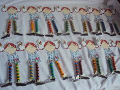 "These are the ""Pippi Lollylegs"" we made as party favours - Pippi printed out on card, cut out and her legs replaced with 1""x8"" cellophane tubes (cut in half) filled with M&Ms."