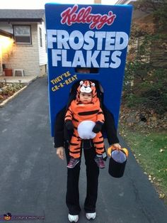 Feed your inner child as a box of Frosted Flakes (with real life Tony the Tiger baby attached). #HalloweenCostumes #FoodCostumes