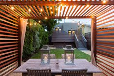 Sophisticated Fairy Lights In The Outdoor Space: Ingenious Pergola Design Illuminated With Alluring Fairy Lights And Cozy Chairs And Table Idea Perfected With Lanterns In Pretentious House ~ Manningmarable