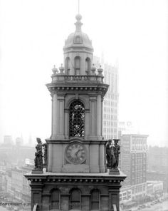 The cupola and the Maidens of Virtue on top of Old City Hall - Detroit