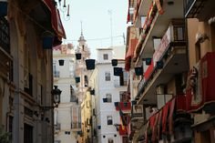 Two blocks from the Cathedral is this narrow street lined with buckets on Corpus Cristi. Those balconies are lined with buckets too - all filled with water and with people to refill them once they've dumped them over the heads of Herod's men.