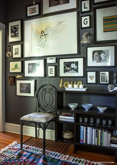 Lia Griffith's home: gallery wall  (mostly black Ikea frames)  // charcoal wall paint is Sherwin Williams Peppercorn