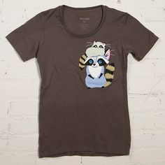 This shirt is so meta. A raccoon wearing a raccoon as a raccoon cap. Our minds are boggled.