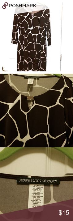 "Ohh la la giraffe print dress New as in never used dress by aDressing Woman in a giraffe print.   Chest measures 19"" from armpit to armpit Length 34"" from shoulder to hem Sleeves measure 18"" from shoulder, not a long sleeve dress. aDressing Woman Dresses Midi"