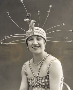 sequined beaded gown and a crown/headdress with long sprigs like tentacles ...Yetta Rianza in Joy-Land!, 1916