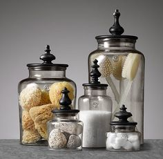 ^Up-cycle jars of different sizes with repainted lids and add finials to store you're bathroom necessities.
