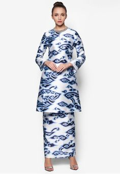 Cipayung Kurung from Rizalman for Zalora in White and Blue Homegrown fashion designer Rizalman for Zalora unites the best of the classic and contemporary in this delightful baju kurung. Featuring a two-piece design, the brand amplifies the traditional ensemble with multi-coloured cloud motif.   Top - Pol... #bajukurung #bajukurungmoden