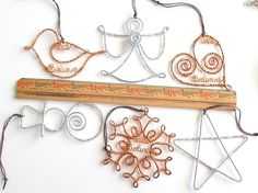 Wire Name Snowman Christmas Ornament custom handcrafted with your favorite word or name and year. The silver snowman is made with steel fencing wire and the copper snowman is made with copper electrical wire. Each snowman features sweet swirl for a scarf & the year wired in as a hat band.  Give year & name or word (up to 9 letters) - You can put the note in Add an optional note to the seller just under the Submit Order section after you place it in your cart Measurements: approximately 4 1/2…