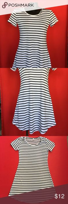 "CLASSIC STRIPED T SHIRT DRESS🍒 I bought this adorable dress on Posh but it just doesn't work on me😢 It is a great dress or tunic for everyday and perfect as a swim cover up. Worn once and dry cleaned. It has a few little black spots ( see pics) that were there when I bought it. Not too noticeable and priced accordingly. Marked a small it measures 33"" long; 16"" pit to pit. Very flattering cut and classic striped! Perfection🍒 purple month Dresses Mini"