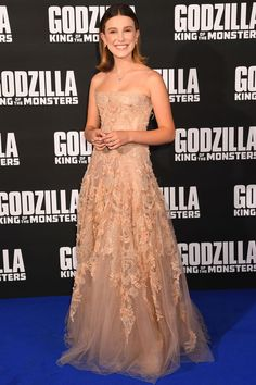 """28 May 2019 — Millie Bobby Brown wore a 'Dior' gown w/ 'Selim Mouzannar' jewellery & 'Tabitha Simmons' shoes to the """"Godzilla II King of the Monsters"""" London premiere. Millie Bobby Brown, Event Dresses, Nice Dresses, Prom Dresses, Celebrity Dresses, Celebrity Style, Popsugar, Dior Gown, Bobby Brown Stranger Things"""