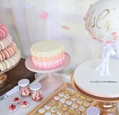 Pink, white, peach and gold dessert table! Ball cake, gold cookies, a small buttercream smash cake and cheesecakes in jars