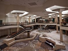 Just dust: These haunting images show the dust-covered remains of what were once thriving shops and bustling stairwells