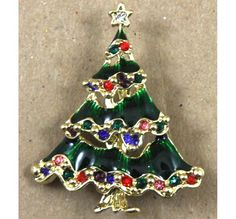 "Assorted round rhinestone embedded filigree enameled gold tree pin Dimensions: 1.5"" X 2"""