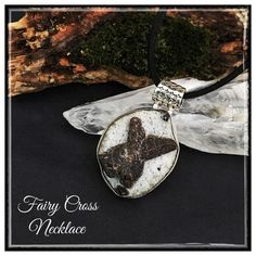 ✨Beautiful Fairy Cross (Staurolite) Necklace✨ ✨The legend of Fairy Crosses goes that when the fairies learned about Christ's crucifixion, they cried. Their tiny tears fell to earth✨Magically these tears crystallized into the Fairy Crosses. The legends tell us that Fairy Crosses will enhance your good luck and can serve as a protection against bad luck✨Fairy Crosses also strengthen the rituals in White Magic ceremonies. They are also known to connect the spiritual, emotional, and physical…