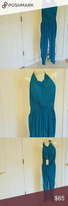 NWT Calypso St Barth JYLER jumpsuit XS Calypso st Barth XS turquoise halter top jumpsuit.New with tags. 100%poly.fun vibes Calypso St. Barth Other