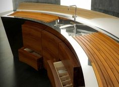 Luxury Kitchen Cabinet...Note to self..perfect for our flow of traffic to have the curve.