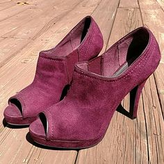 "Plum Ankle Heels. Open-Toe. 7 1/2 High heels. Fabric-like texture. Stretch on the sides. Very minor spot on left heel the blends in and slight scruff to fronts. Nothing that defects the heels. 4 1/2"" heel. Fioni Shoes Heels"