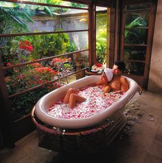 #IgniteTheSpark with a private soak in a tub full of petals at @Four Seasons Resorts Bali.