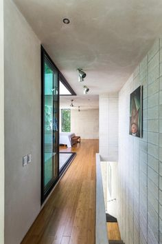 Raw House - Maximizing Vertical Space and Light on a Narrow Lot (13)
