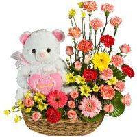 Sweet Sentiments-Show her you care with our Sweet Sentiments arrangement. This exquisite arrangement contains Gerberas, Carnations and many more with a cute teddy. Seasonal availability of flowers may require our florists to substitute flowers which are similar in style quality and value.
