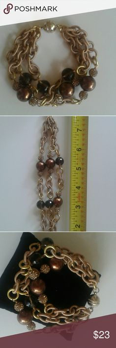 🎅Final Price🎅Silk Wrapped Chain Bracelet Multi strand silk wrapped chain bracelet with silver look strong magnetic closure. Rhinestone and rust color bead look. Fits a 6-7 wrist approx. Custom made in the USA Designer. Gorgeous on. New and never worn. Ship with POSHMARK Priority Label furnished. Post Office closes on Sat. @ 1pm and reopens on Mon. Please keep this in mind when placing your order. Appreciate your Business! Jewelry Bracelets