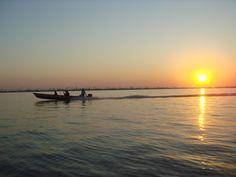 Fishing at sunrise, Amazon, Brazil.