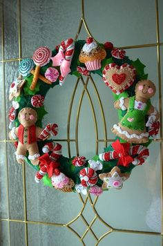 20 Strikingly Unique Christmas Wreath Ideas These Christmas wreath ideas are unique enough to have any of your guests loving them this holiday season! Felt Christmas Decorations, Xmas Wreaths, Felt Christmas Ornaments, Christmas Candy, Burlap Christmas, Beaded Ornaments, Snowman Ornaments, Christmas 2019, Christmas Christmas