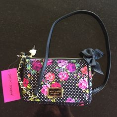 Betsey Johnson bag Betsey Johnson crossbody wallet bag, zip area and lift pocket for wallet area.  Very beautiful, iconic black & pink flower pattern.  New with tags attached. Betsey Johnson Bags Crossbody Bags